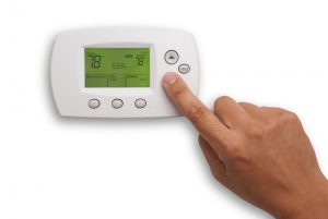 finger-on-thermostat